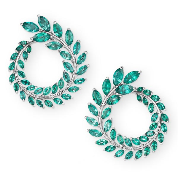 A pair of green carpet emerald earrings displayed on a white background.