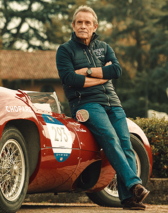 Jacky Ickx standing and wearing a watch from the Mille Miglia Collection