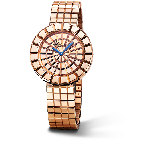 A gold Ice Cube watch with its two royal blue hands.