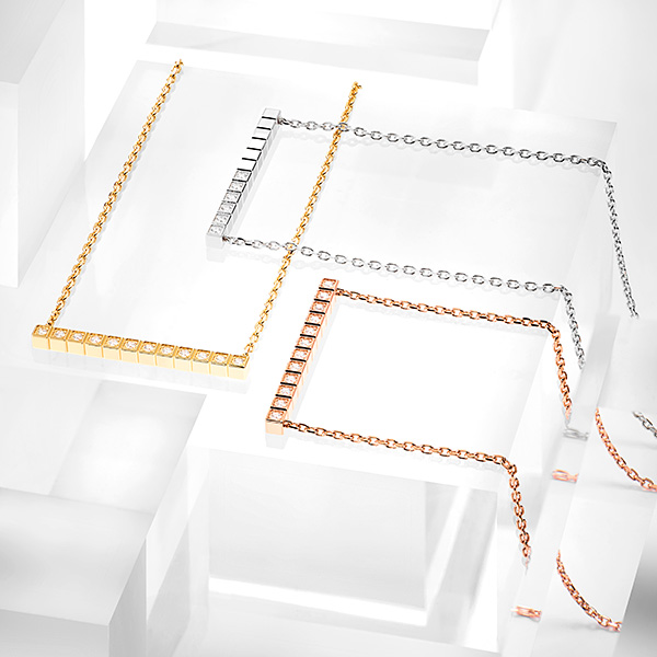 The Ice Cube Collection (earrings, necklaces, bracelets, rings and pendants) displayed over a transparent, grey showcase. 1