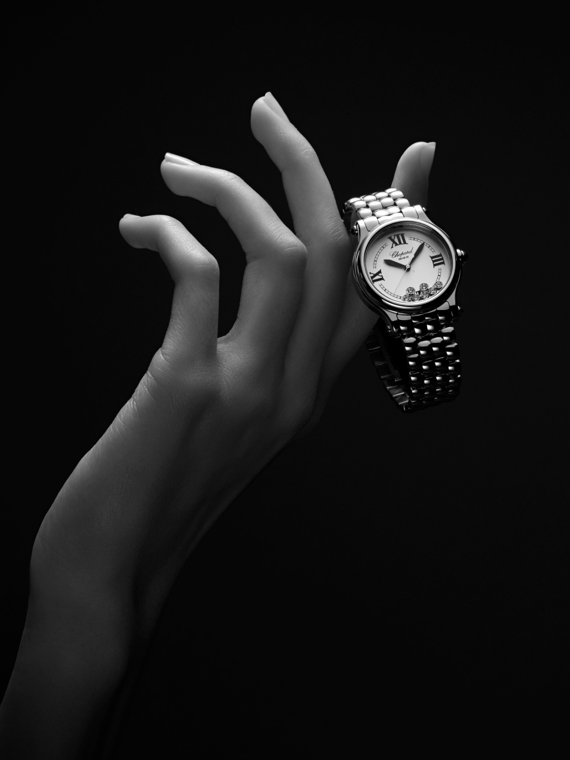 Close-up of an hand holding the happy sport first, watch of chopard