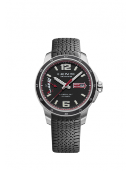 front of stainless steel watch with black dial and chronometer on black rubber strap